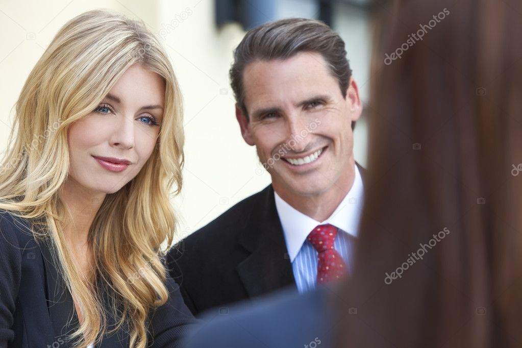 A beautiful businesswoman in a meeting with her male and female colleagues — Stock Photo #6485532