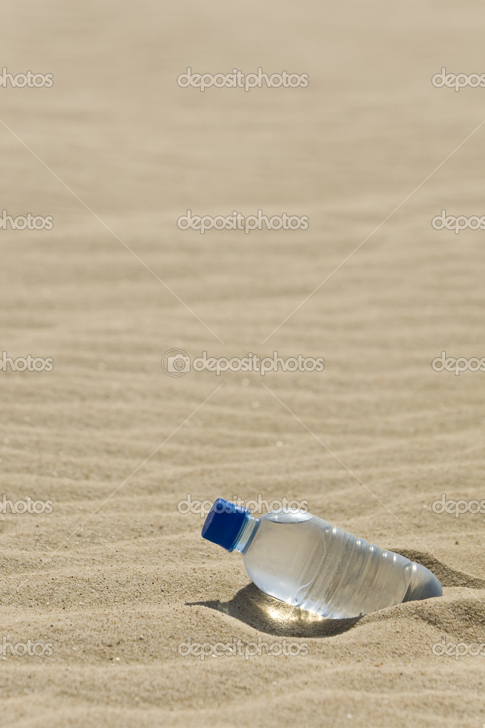 Bottle of Water In A Desert of Sand — Stock Photo ...
