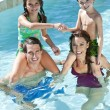 Happy Family With Two Children Playing In A Swimming Pool — Stock Photo #6673186