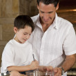 Father and Son In Kitchen Cooking Baking Cookies — Stock Photo #6673188