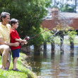 Father Fishing With His Son On A RIver — Stock Photo #6673189