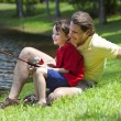 Father Fishing With His Son On A RIver — Stock Photo #6673190