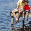 Father Fishing With His Son On A Pier — Stock Photo
