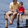 Father Fishing With His Son On A Jetty — Stock Photo