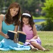 Woman and Girl, Mother and Daughter, Reading a Book Together Out — Stock Photo