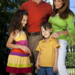 Modern Family Having Fun In A Park - Stock Photo