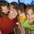 Modern Family Having Fun In A Park — Stock Photo