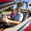 Family Driving In Convertible Car — Stock Photo #6673223