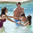 Happy Family With Two Children Playing In A Swimming Pool — Stock Photo #6673226
