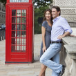 Romantic Couple by Traditional Red Phone Box in London, England — Stock Photo