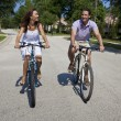 Stock Photo: Romantic Man and Woman Couple Cycling Together