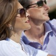 Royalty-Free Stock Photo: Attractive Thirties Couple In Sunshine Wearing Sunglasses