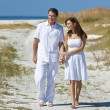 Romantic Couple Walking Holding Hands on An Empty Beach — Stock Photo
