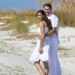Romantic Man and Woman Couple Walking on An Empty Beach — Stock Photo #6673294