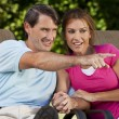 Happy Middle Aged Man Woman Couple Holding Hands and Pointing — Stock Photo #6673325