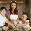Mother, Son & Daughter Family In Kitchen Cooking & Baking — Stock Photo #6673332