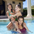 图库照片: Happy Family With Two Children Playing In A Swimming Pool