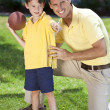 Father Teaching His Son To Play American Football — Stock Photo