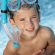Stock Photo: Happy Boy In A Swimming Pool with Goggles and Snorkel