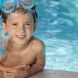 Happy Boy In Swimming Pool With Blue Goggles and Snorkel — Stock Photo #6673365