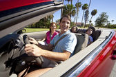 Family Driving In Convertible Car — Stock Photo