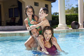 Happy Family With Two Children Playing In A Swimming Pool — Stock Photo