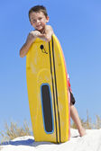Young Boy Child With Surfboard At The Beach — Stock Photo