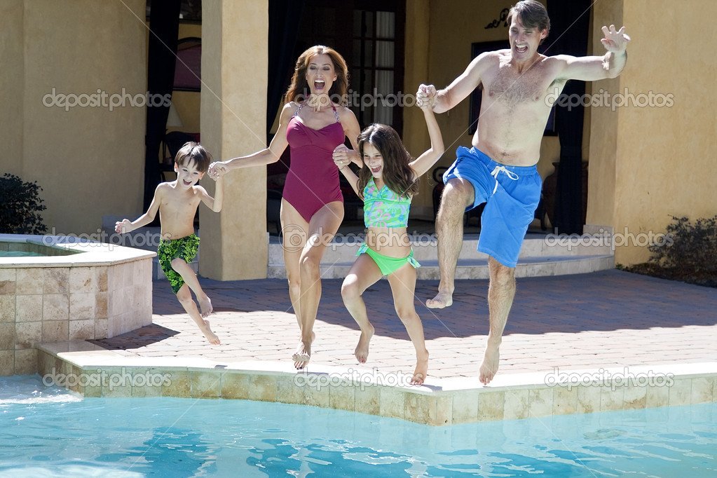 images of Family With Two Children Having Fun Jumping Into Swimming