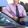 Businessman Leaning on Car with Tablet Computer — Stock Photo #6684665