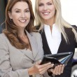 Two Businesswomen with Tablet Computer - Stock Photo