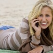 On The Beach and On The Phone — Stock Photo