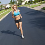 Beautiful Blond Woman Running In Suburban Street — Stock Photo