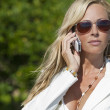 Beautiful Blond Woman In Sunglasses Talking On Cell Phone — 图库照片