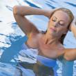 Sexy Blond Woman in White Bikini Emerging From Swimming Pool — Stock Photo #6685396