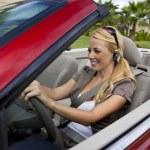 Beautiful Young Woman Driving Convertible Car Talking on Bluetoo — Stock Photo