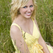 Beautiful Blond Woman Sitting In Tall Grass — Stock Photo