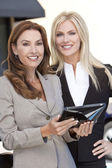 Two Businesswomen with Tablet Computer — Stock Photo