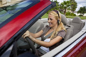 Beautiful Young Woman Driving Convertible Car Talking on Bluetoo — Stock Photo