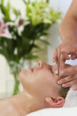 Beautiful Young Woman Having Facial Massage Treatment at Health — Stock Photo