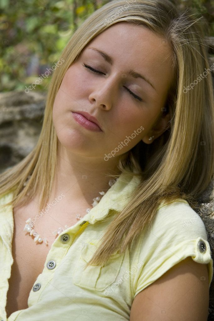 A beautiful young blonde woman sleeping while bahed in warm summer sunshine — Stock Photo #6685453