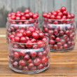 Cherries in glass jars. — Stock Photo
