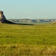 Pawnee buttes with wind mills — Stock Photo