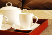 Close up of a tea set on a bed — Stockfoto