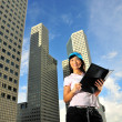 Asian healthy girl holding a file outdoors - Stock Photo