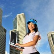 Asian Chinese Girl holding a laptop - Stock Photo