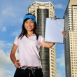 Asian Chinese Lady holding clipboard - Stock Photo