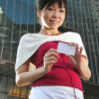 Asian Chinese female in various poses showing name card — Stock fotografie