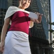 Asian Chinese female in various poses showing name card — Stockfoto