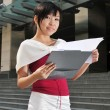 Asian Chinese Office Worker with a clipboard — Stockfoto