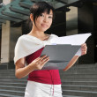 Asian Chinese Office Worker with a clipboard — Stock fotografie